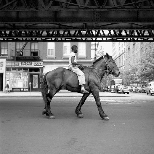 vivian maier a man on a horse under ubahn line
