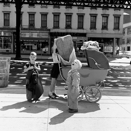vivian maier children with a pram tube line behind them