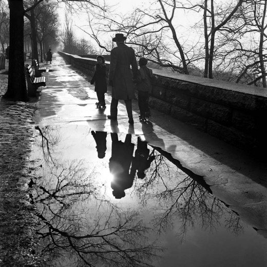 vivian maier father and children reflected in a paddle