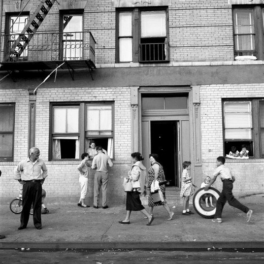vivian maier street scene with a tyre