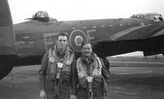 Reporter Wynford Vaughan Thomas and sound engineer Reg Pidsley in front of a Lancaster bomber, September 1943; the pair flew on an RAF raid to Berlin on the night of 3 September 1943, and their report was broadcast 'live' on BBC Radio two days later.
