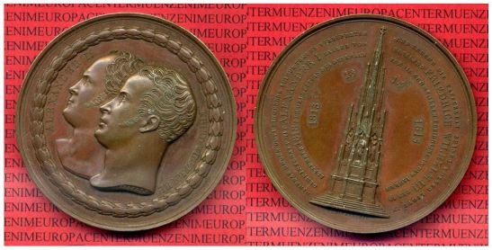 The original 1818 medals featuring Friedrich Wilhelm III and Alexander I on the obvers and the memorial itself on the reverse (photo: Münzen am Zoo Berlin Leihhaus - Thomas Polland, where the medal can be purchased as well)
