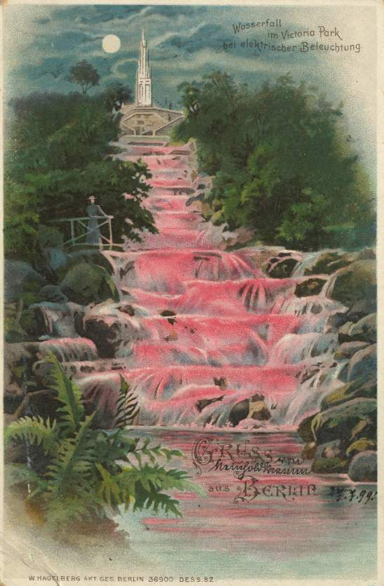 BEAUTIFULLY ILLUMINATED WATERFALL IN VIKTORIAPARK IN BERLIN-KREUZBERG AROUND 1899.