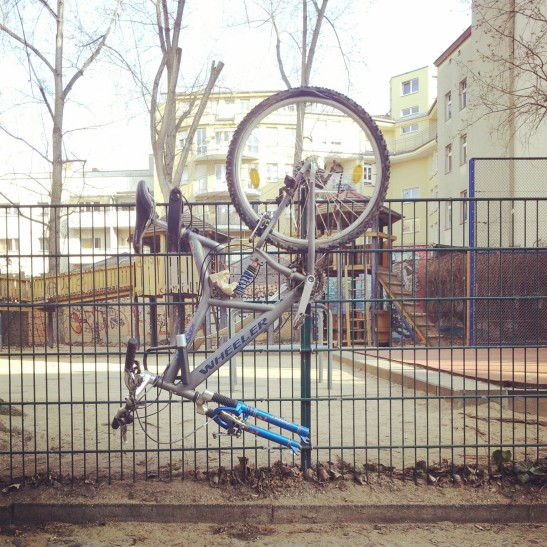 Bicycles, like butterflies in their cocoons, are hanging there, waiting to hatch (Arndtstrasse)