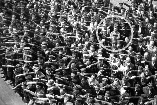 Political rally in 1936 - the man refusing to perform the Hitler Grüß is August Landmesser.