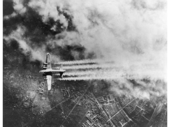 A B-17 Flying Fortress creating contrails in the sky over Berlin on February 3rd, 1945,