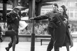 Pedestrians in the Wind, Alexanderplatz in 1990 (image by Ralph Hirschenberger, Bundesarchiv)