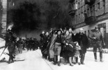 Suppression of Warsaw Ghetto Uprising - Captured Jews are led by German Waffen SS soldiers to the assembly point for deportation (Umschlagplatz).