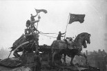 The 1945 victors on top of the Brandenburg Gate with the badly damaged Quadriga.