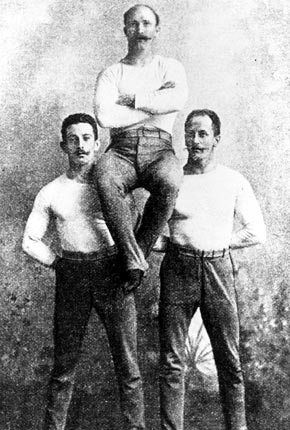 The three German gold medal winners of the 1896 Olympics in Athens: Schuhmann, Flatow (in the middle) and Weingärtner. (image author unknown)