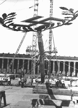 A Maypole topped with a swastika is raised for a May Day parade in the Lustgarten