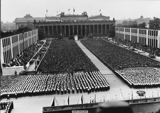 A rally at the 1936 Summer Olympic Games at the Lustgarten, Berlin, Germany, Aug note the Old Museum in background and Nazi tapestries on each side